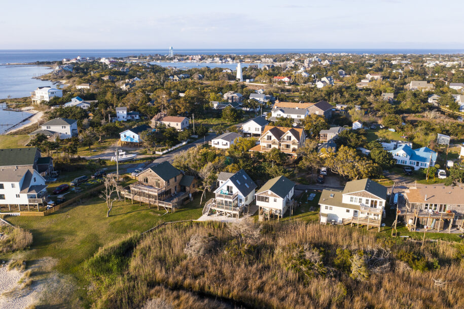 aerial of cottages and lighthouse